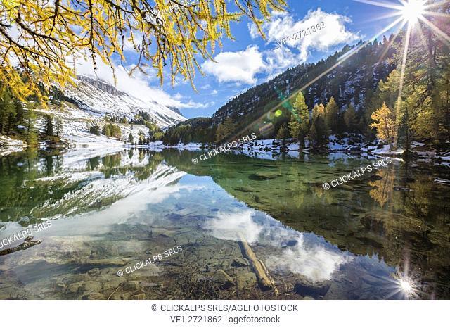 Sun shines on the clear waters of Lai da Palpuogna Albula Pass Bergün Canton of Graubünden Engadine Switzerland Europe