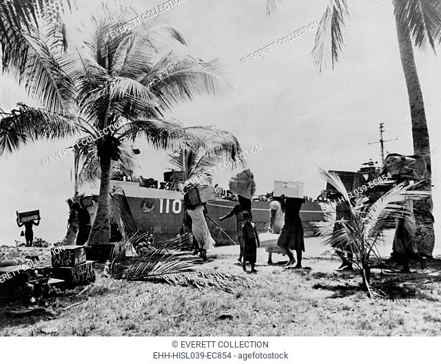 People of Bikini Atoll carry their belongings down to boat. 40 families were 'temporarily' moved to Rongerik Atoll on March 7, 1946