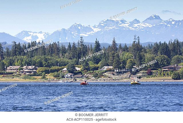 Whale watching boats float down Discovery Passage in search of Humpback Whales, Campbell River, Vancouver Island, British Columbia, Canada