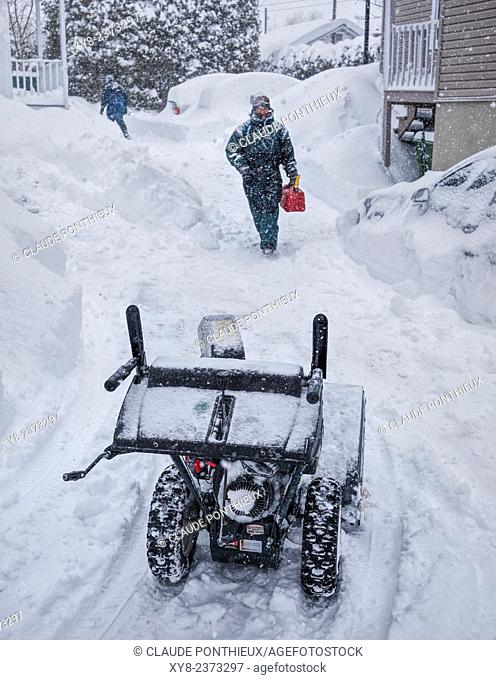 Man about to use his snow-blower, Sherbrooke, Quebec, Canada