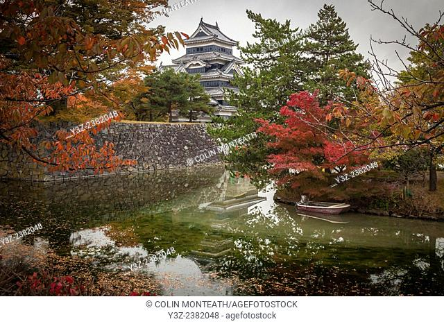 Matsumoto castle reflection in moat, autumn, Japan