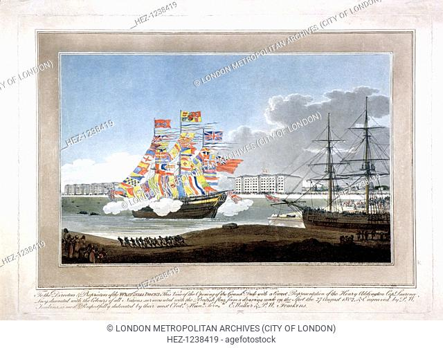 West India Docks, Poplar, London, 1802; scene of the opening of the Grand Dock, 27th August 1802; with the ship the 'Henry Addington' decorated with flags of...