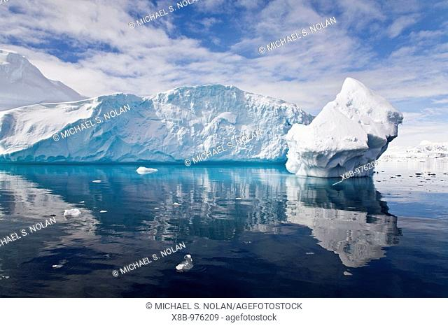 The Lindblad Expeditions ship National Geographic Explorer pushes through ice near Larrouy Island in Grandidier Channel, a navigable channel between the west...