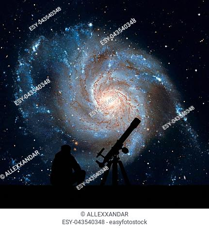 Man with telescope looking at the stars. Pinwheel Galaxy Messier 101, M101 in the constellation Ursa MajorElements of this image are furnished by NASA