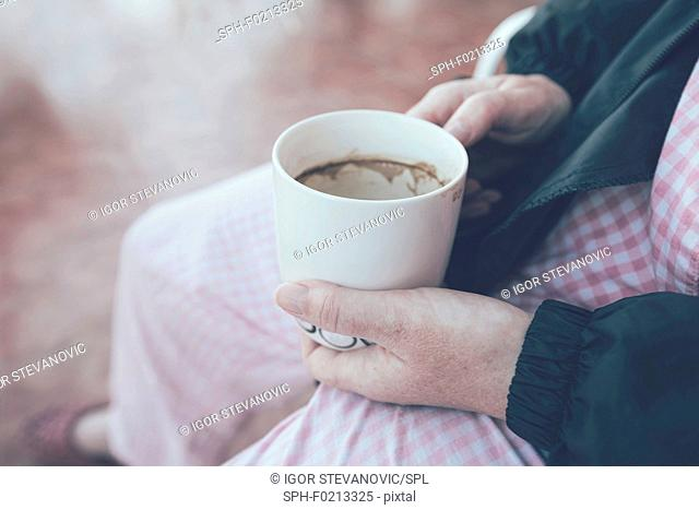 Hospital patient with coffee