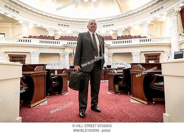 Caucasian politician standing in capitol building