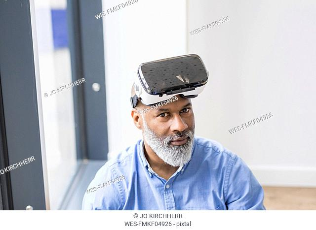 Portrait of businessman with Virtual Reality Glasses