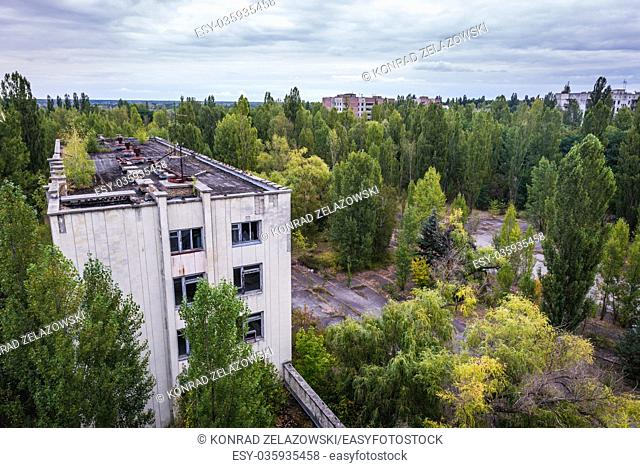 Former administration building seen from Polissya Hotel in Pripyat ghost city of Chernobyl Nuclear Power Plant Zone of Alienation in Ukraine