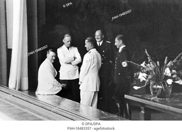 (L-r) Führer Adolf Hitler with Reich Foreign Minister Joachim von Ribbentrop and Italian Foreign Minister Galeazzo Ciano, Count of Cortellazzo and Buccari