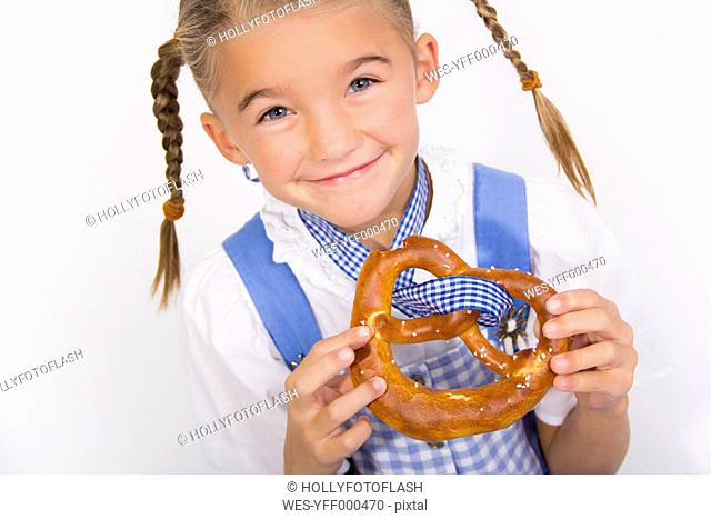 Portrait of smiling little girl with pretzel