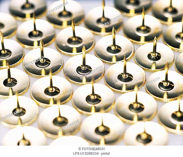 Mass of thumbtacks