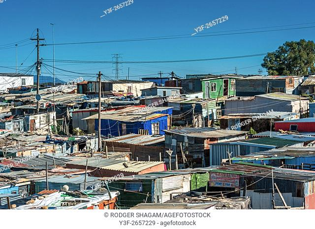 Shantytown made of wood and corrugated iron shacks with electricity supplied . . . Khayalitsha, Cape Town, South Africa