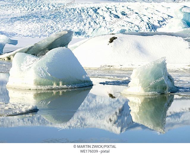 Glacier Fjallsjoekull and frozen glacial lake Fjallsarlon in Vatnajokull NP during winter. Europe, Northern Europe, Iceland, February