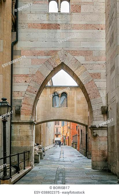 arch and street in historic center of Modena, Italy
