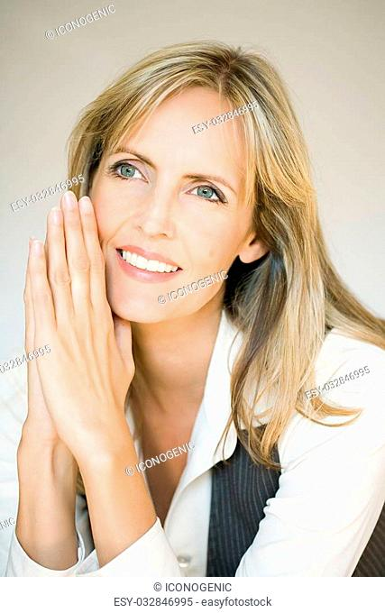 Smiling woman on warm toned background