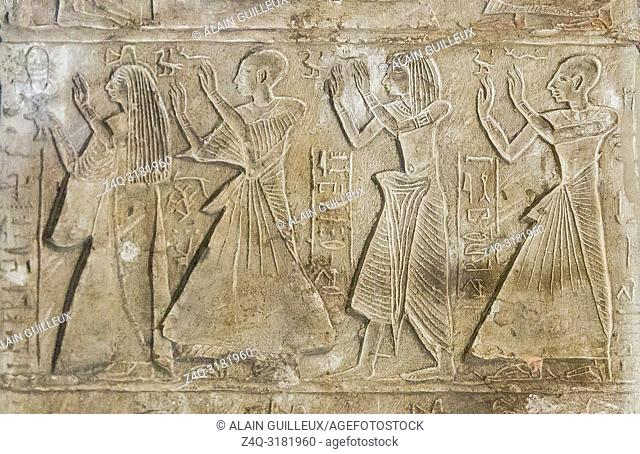 Egypt, Cairo, Egyptian Museum, round-topped stela of Any, general of the temple of Amun. Middle register, relatives of Any are praying