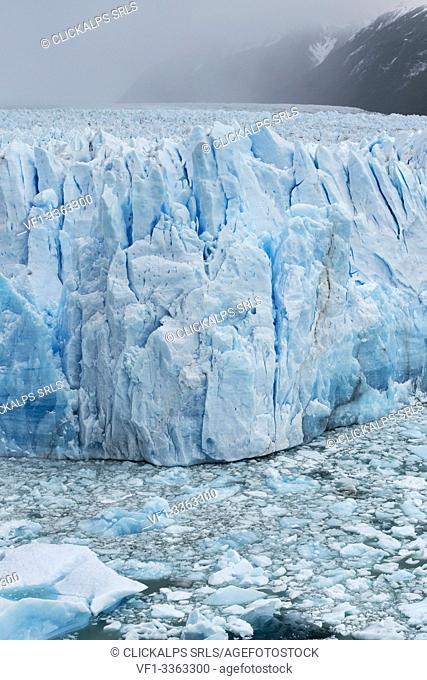 the northern snout of Perito Moreno Glacier and icebergs on a moody day. Lago Argentino department, Santa Cruz province, Argentina