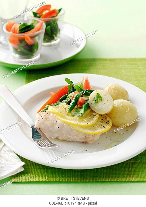 Plate of salmon with vegetables
