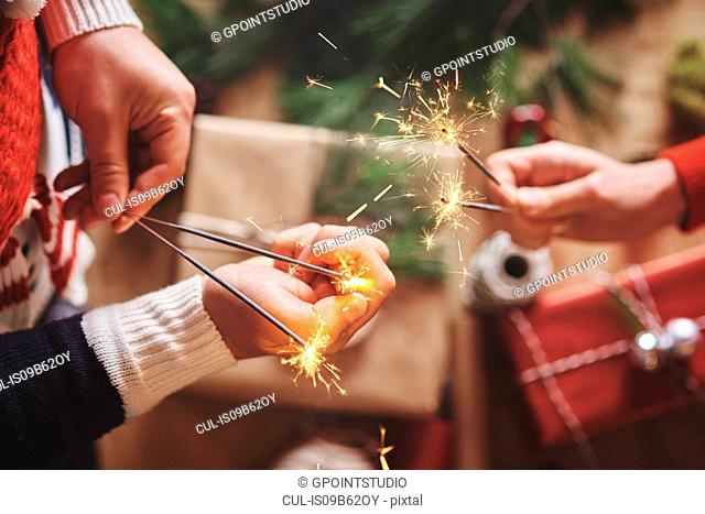 Couple holding indoor sparklers