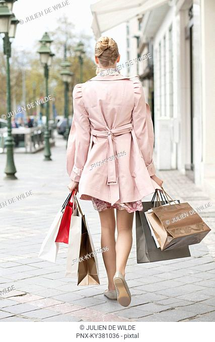 Rear view of a woman carrying shopping bags