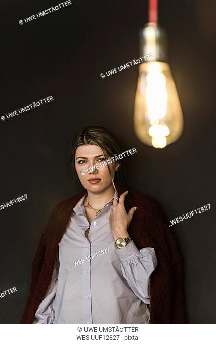 Young woman with illuminated light bulb
