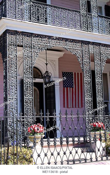 Intricate wrought iron balcony railing of Musson House in Garden District of New Orleans