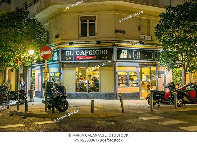 Facade of El Capricho, typical tavern, night view. Lope de Rueda street, Madrid, Spain