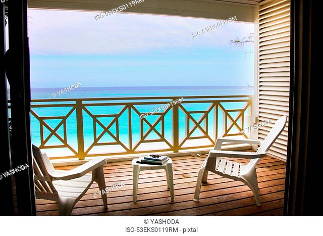 Empty chairs on wooden deck