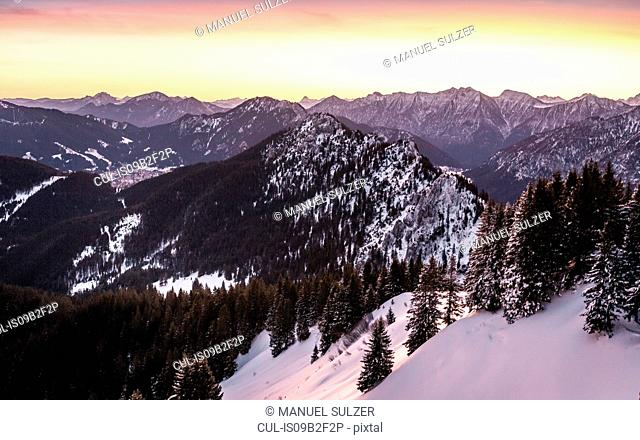 Snow-covered mountain landscape at sunrise, Teufelstattkopf mountain, Oberammergau, Bavaria, Germany