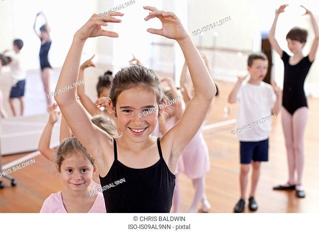 Portrait of girl ballet dancing in ballet school