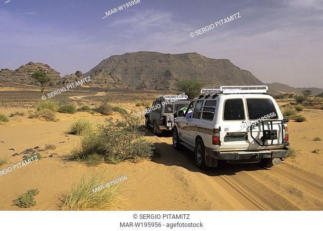 libya, fezzan, sahara desert, akakus, jeeps driving on desert road