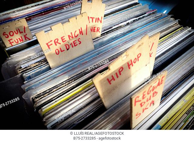 Vinyl records of different music styles: French oldies, hip hop, soul/funk, etc. Second-hand store. London, England