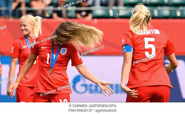 England's Toni Duggan (L) and Steph Houghton celebrate there victory after the FIFA Women's World Cup 2015 third place soccer match between England and Germany...