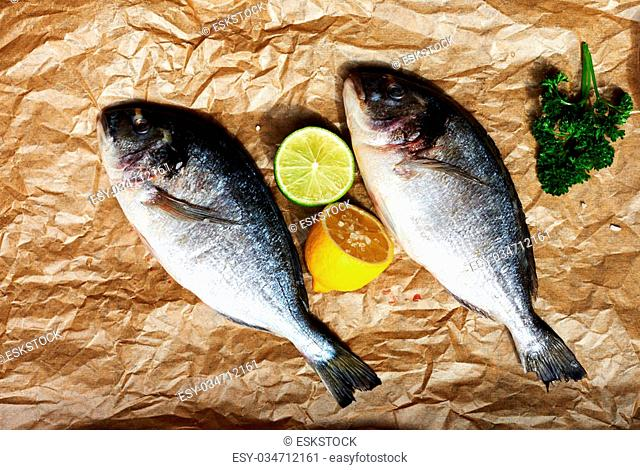 Two fresh chef Dora is going to marinate with lemon, salt and a large bunch of parsley
