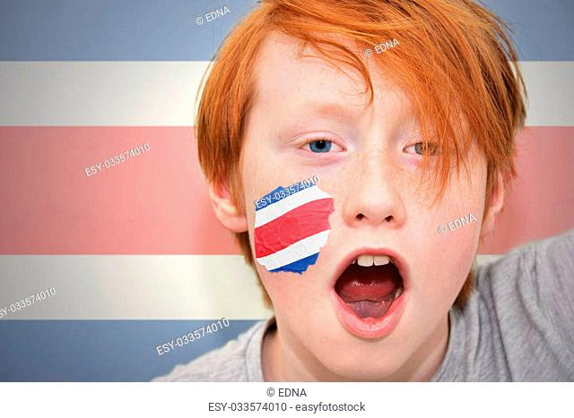 redhead fan boy with costa rican flag painted on his face. on the costa rican flag background