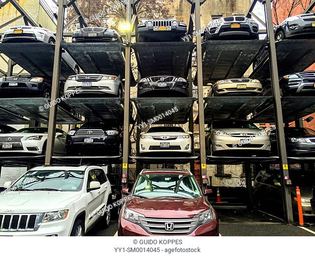 Manhattan, New York, USA. Stack of cars parked in levels and elevations on a parkinglot in Manhattan