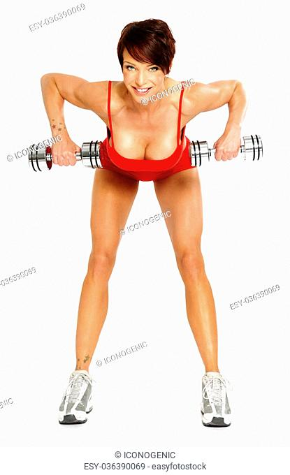 Caucasian woman with short hair on white background wearing red fitness separate and excercising with dumbells
