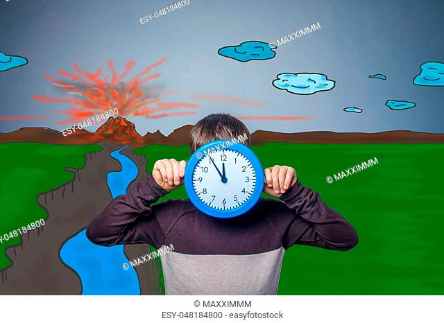 teenage boy closed his round clock face of a volcanic eruption of lava