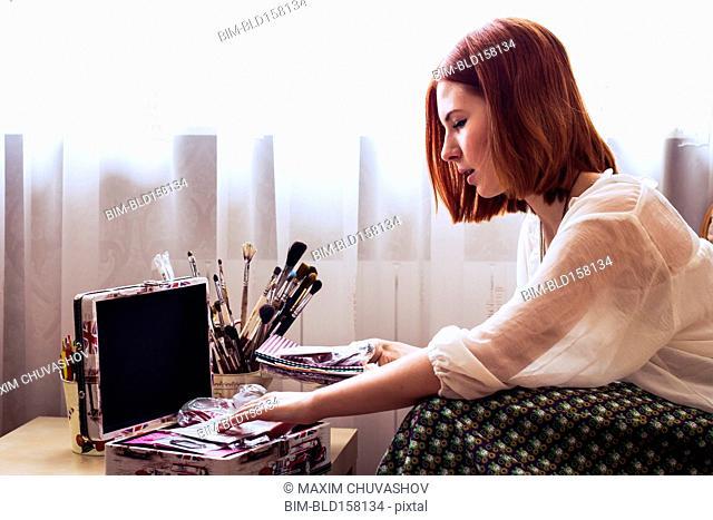 Caucasian woman looking through memory box