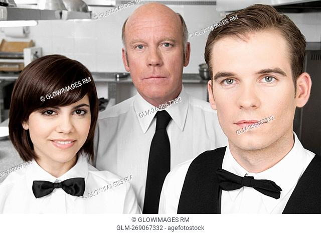 Waiters standing in the kitchen