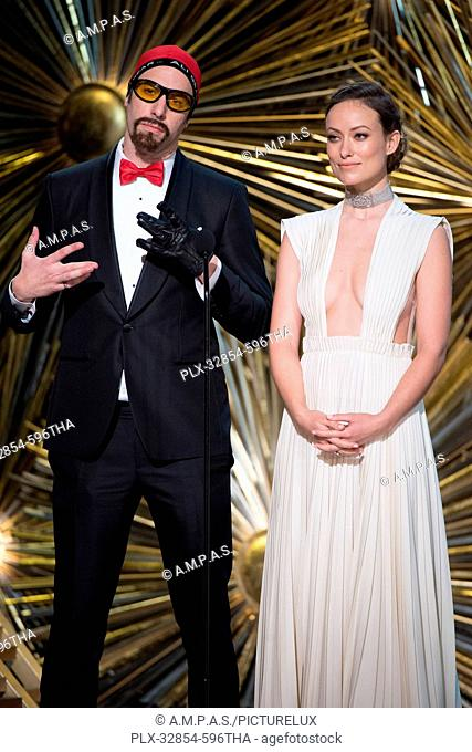 Presenters Sacha Baron Cohen and Olivia Wilde onstage during the live ABC Telecast of The 88th Oscars® at the Dolby® Theatre in Hollywood, CA on Sunday
