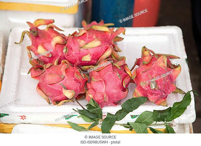 China, guangxi province, yangshuo, dragon fruit in yangshuo market