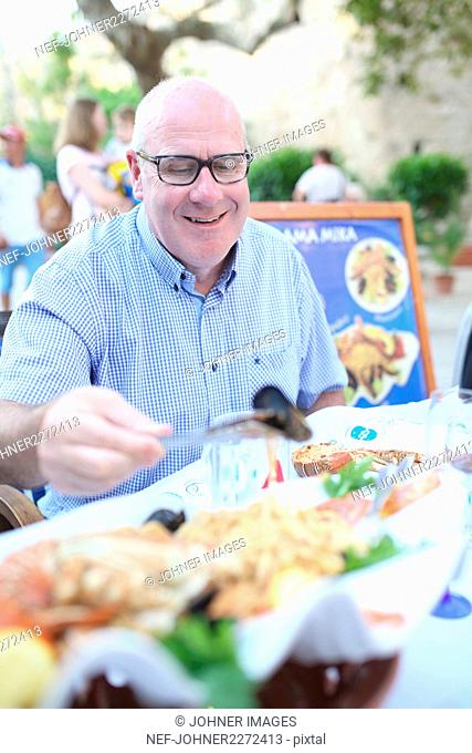 Senior man in outdoor restaurant