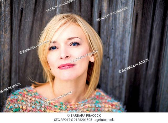 Portrait of woman in bright sweater