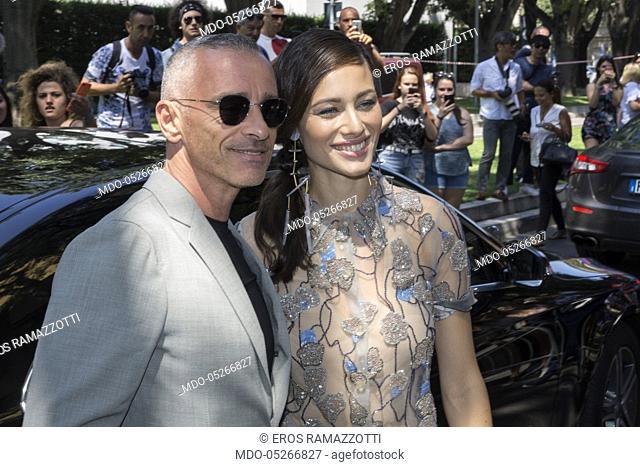 Italian singer Eros Ramazzotti and his wife Marica Pellegrinelli attends at Giorgio Armani catwalk during the Milan Fashion Week Man spring/summer 2018