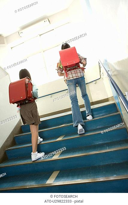 Japanese Students Walking Up Stairs