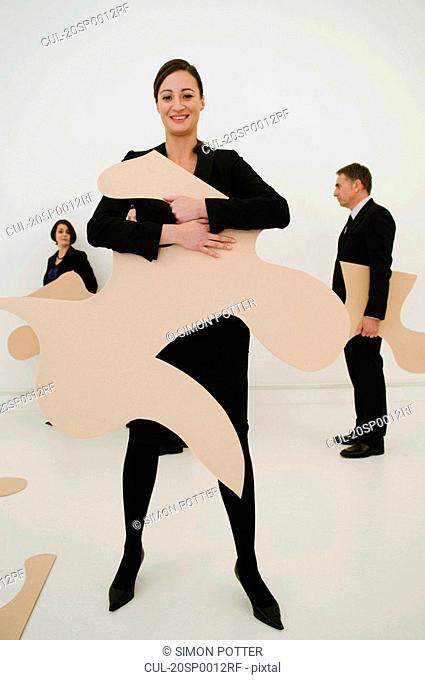 Happy Women holds large jigsaw piece