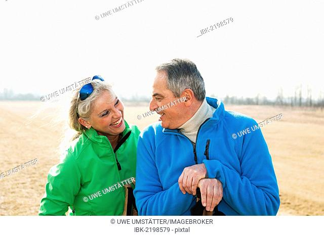 Smiling senior couple on a meadow