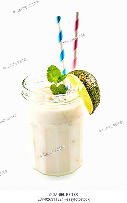 Single screw top glass jar as cup full of sweet coconut and alcohol with lime and two straws over white background
