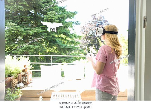 Woman wearing VR glasses navigating a drone